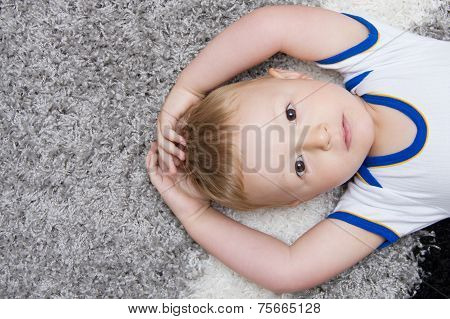 Cute Baby Lying On Back
