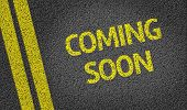 Coming Soon written on the road poster