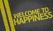 Welcome to Happiness written on the road poster