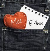 """Mae, Te amo"" (In portuguese - Love You, Mom) written on a peace of paper and a heart on a jeans background poster"
