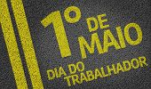 1 de Maio, Dia do Trabalhador (In Portuguese: 1 May, Labor Day) written on the road  poster