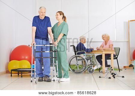 Old man with walker during pyhsiotherapy in a nursing home