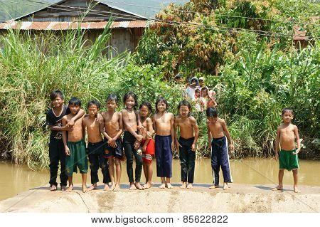 Asian Children Bath In The River