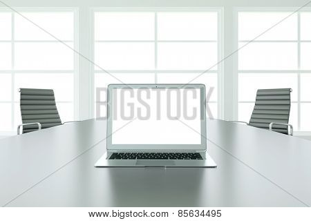 Empty white monitor of laptop computer during business presentation on a table (3D Rendering)