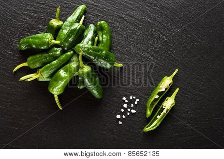 Raw Pimientos De Padron On Black Background Top View
