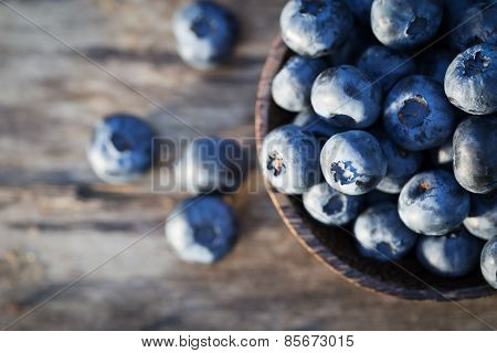 Fresh sweet tasty blueberries on a wooden background poster