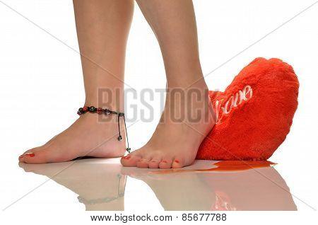 Female feet, trampling loving heart