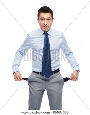 business, people, emotions, bankruptcy and failure concept - surprised businessman showing empty pockets