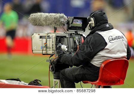 BARCELONA - 4, MAR: Television camera broadcasting football spanish league match at the Estadi Cornella on March 4, 2015 in Barcelona, Spain