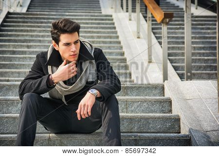 Trendy Handsome Young Man Sitting On A Long Staircase Outside