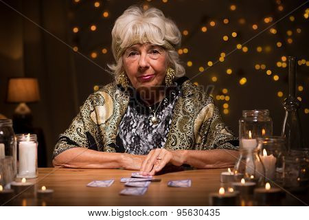 Picture of mature fortune teller with tarot cards poster