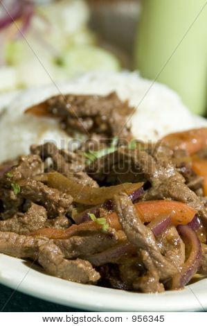lomo saltado peruvian marinated steak sliced with vegetables and rice poster
