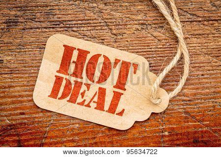 hot deal sign a paper price tag against rustic red painted barn wood