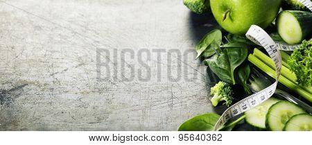 Fresh green vegetables on vintage background - detox, diet or healthy food concept
