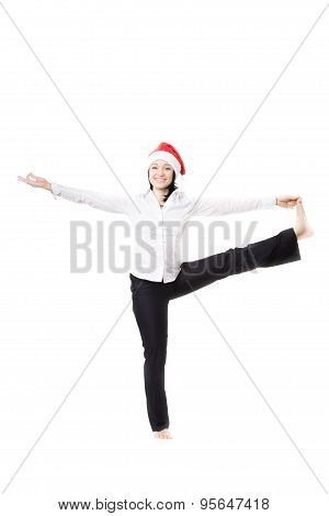 Young Office Woman In Big Toe Yoga Pose In Santa Claus Hat On White Background