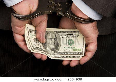 Dollarnoten und Handschellen
