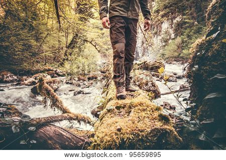 Feet Man hiking outdoor with river and forest on background