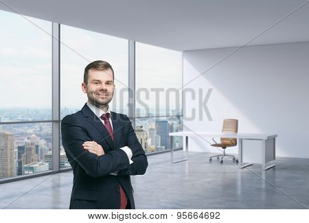 A handsome businessman in a workplace at modern corner panoramic office in New York Manhattan. A concept of financial consulting services. poster