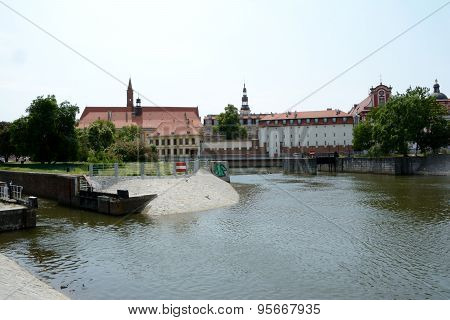 Odra River Canal And Old Buildings In Wroclaw, Poland.