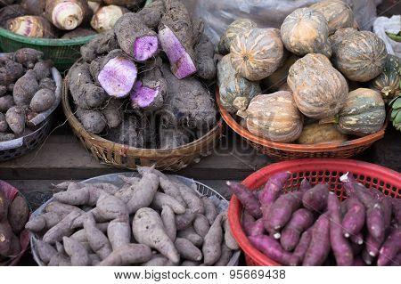 Background Of Sweet Potato, Potato, Ginger, Onion And Others At Local Street Market, Saigon, Vietnam