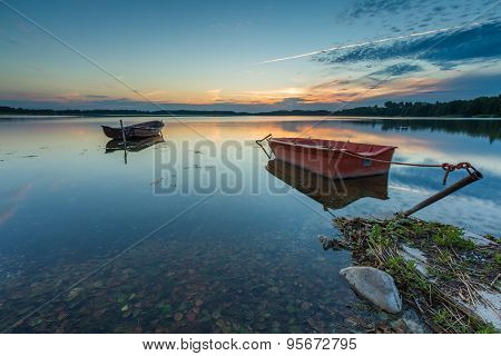 Beautiful Lake Sunset With Fisherman Boats