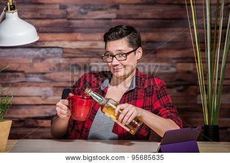Woman Drinking At Desk
