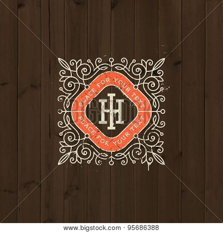 Vintage monogram logo template with flourishes elegant ornament elements on a old wooden background. Identity design with letter for cafe, shop, store, restaurant, boutique, hotel, fashion and etc.