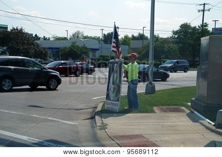 Man with Sign and Flag