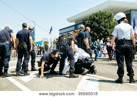 French police arresting man at protest