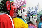 Ondel-ondel is a traditional big doll from Betawi's culture a Jakarta's traditional culture that used in exorcise ritual in the past but in modern days is used to entertain people. The red face is the man & The white face is the woman. poster