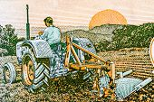 Indian 5 rupee note depicting the importance of farming using modern equipment - tractor poster