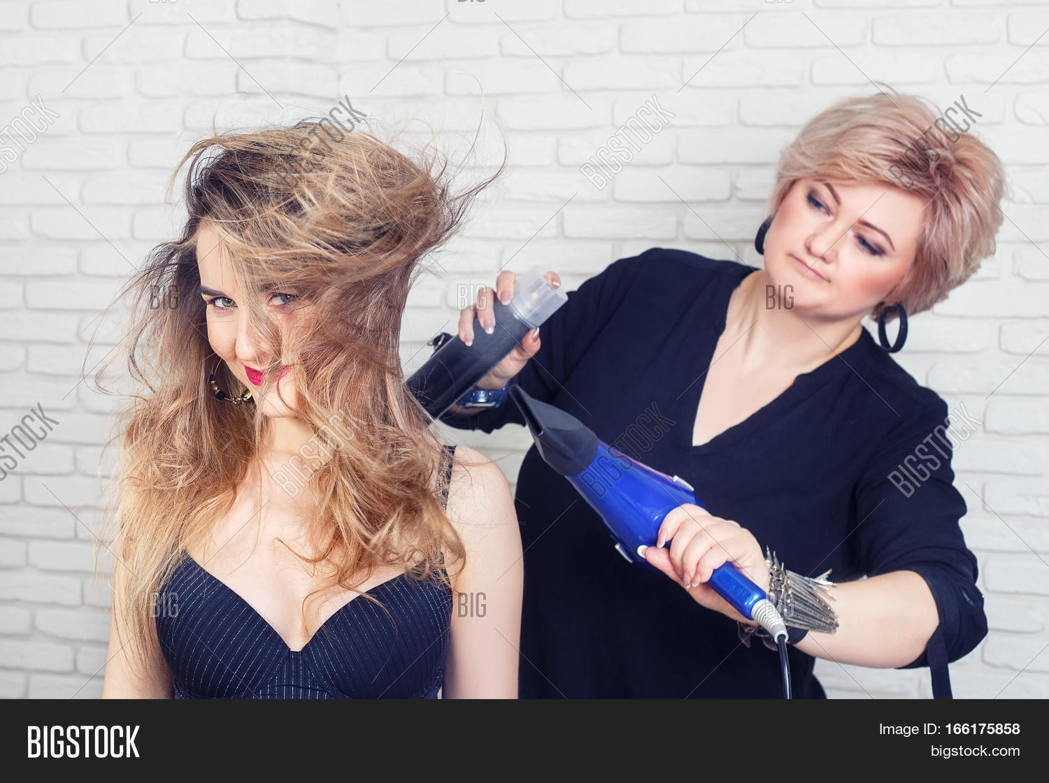 Hairdresser Drying Woman S Hair After Giving A New Haircut Portrait Of Hy At