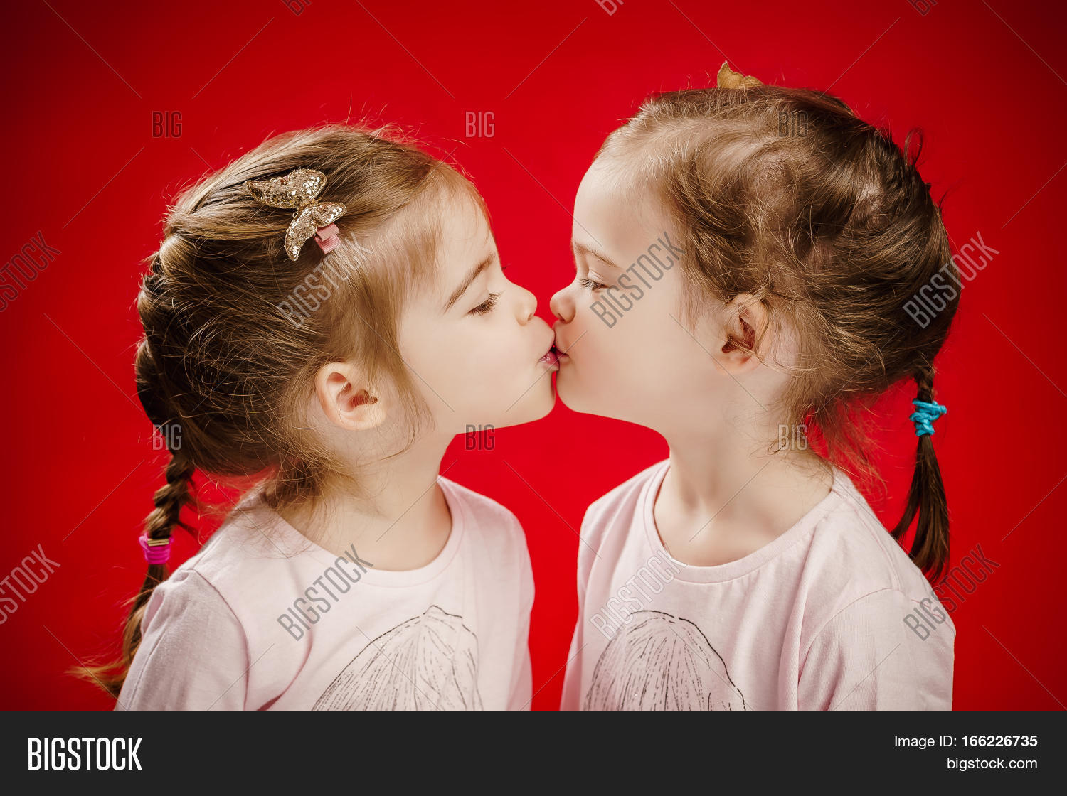 Twins Kissing Each Other