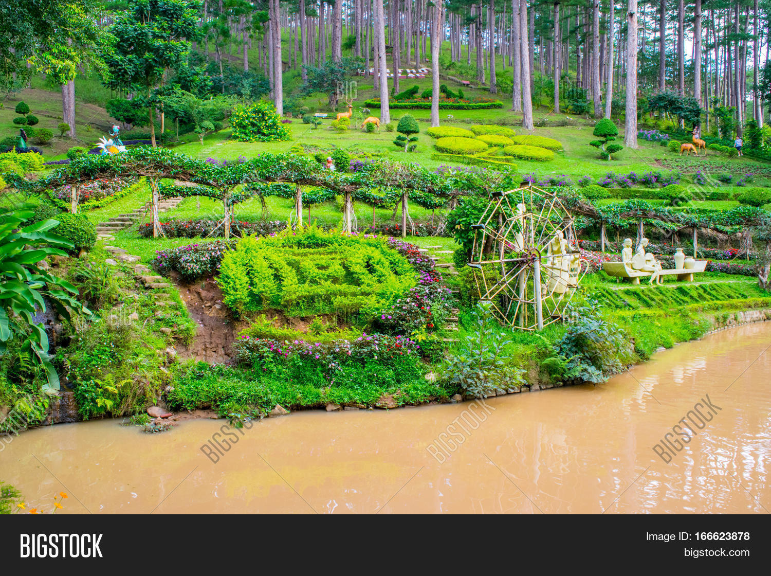 Landscape Design Of Relax Tropical Garden With Statues On A River Side,  Dalat City,