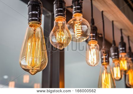 Decorative antique edison style filament old lighting decor bulb in modern building. Select focus