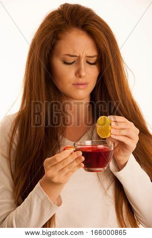 Illness Flue Woman With Cup Of Tea And Lemon Over White Background
