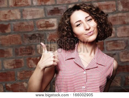 lifestyle  and people concept: Happy young woman giving thumb up