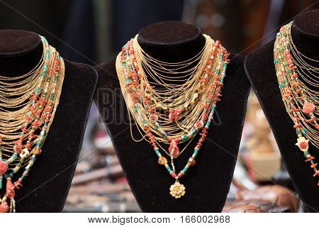 indigenous micro-bead jewelry in the artisan market in Otavalo Ecuador