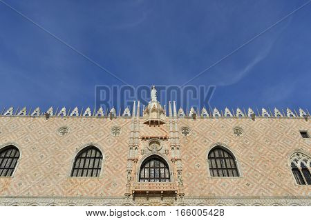 Beautiful gothic Doge Palace southern facade in Venice with blue sky and copy space