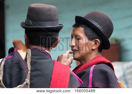 September 6 2016 Silvia Colombia: indigenous Guambiano men closeup portrait in the local market wearing traditional outfit