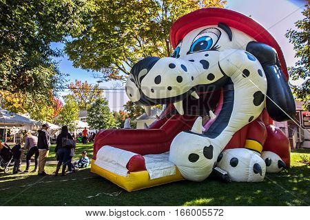 White Plains, NY, October 15, 2016: Dalmatian the fire dog inflatable slide is set up for a kid oriented event.