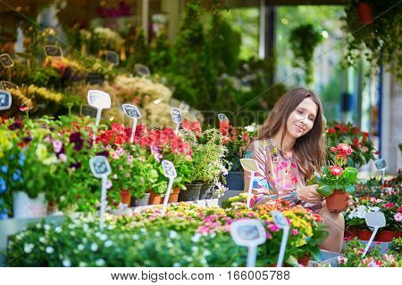 Woman Selecting Flowers On Parisian Flower Market Or In Shop