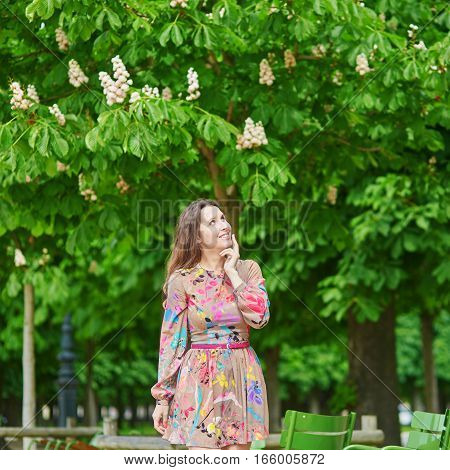 Young Woman In The Tuileries Garden, Walking Under Chestnut Trees In Full Bloom