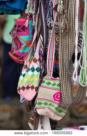 September 6, 2016 Silvia, Colombia: colourful handmade knitted traditional indigenous shoulder bags in the artisan market