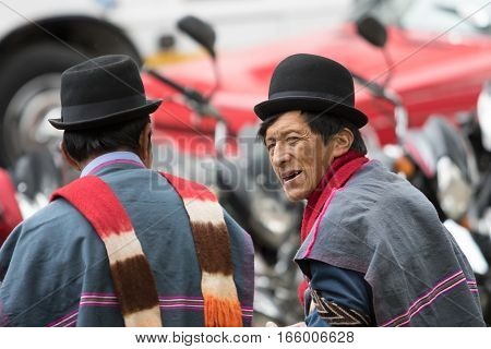 September 6 2016 Silvia Colombia: indigenous Guambiano men in traditional wear interacting outdoors