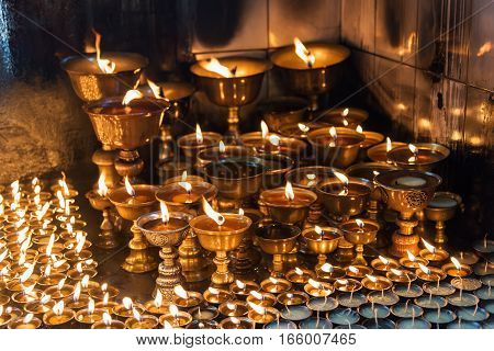Lighting a lamp for peace from Shree Boudhanath Kathmandu, Nepal.