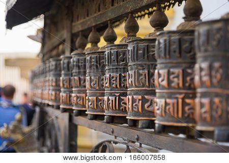 Prayer wheels in Swayambhunath temple ,Kathmandu, Nepal.