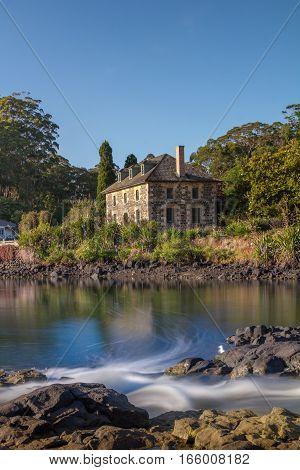 Historic Stone Store in Kerikeri New Zealand Looking over the Stone Store Basin Vertical