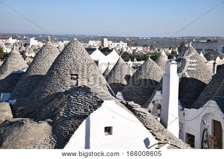 Aerial view of the traditional trulli houses with their conical roof in Alberobello, Apulia, Italy