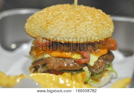beef burger with cheese ,  sesame  and vegetable